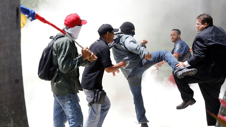 Government supporters clash with members of Venezuela's opposition-controlled National Assembly
