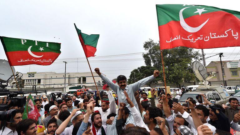 Tehreek-e-Insaf party activists celebrate Sharif's dismissal