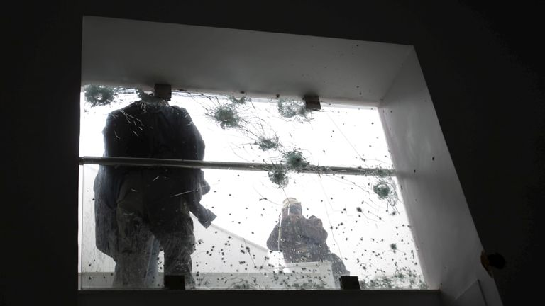 Bulletholes cover a window in the Bardo after the two gunmen were gunned down