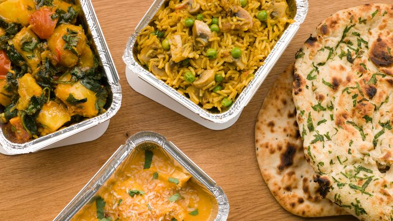 Generic takeaway image - Chicken Korma, Sag Aloo, Mushroom Pilau And Naan Bread - Stock image