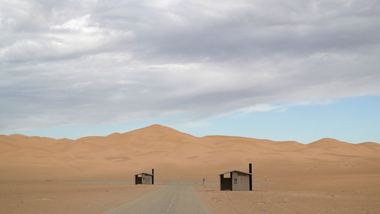 IMPERIAL SAND DUNES, CA - SEPTEMBER 27: Restrooms stand at the ready for campers near the U.S.-Mexico border fence on September 27, 2016 in the Imperial Sand Dunes recreation area, California. The border stretches almost 2,000 miles between Mexico and the United States. Border security and immigration issues have become major issues in the U.S. Presidential campaign. (Photo by John Moore/Getty Images)