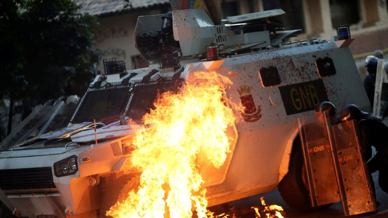 A riot security force vehicle is set on fire