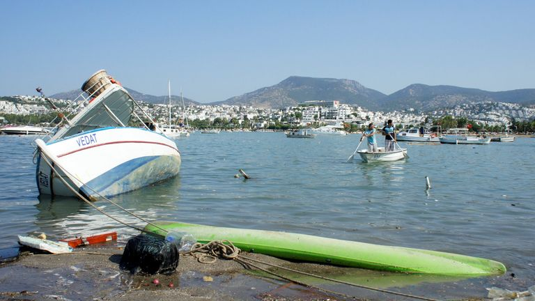 Damaged boats after an earthquake and a tsunami in the resort town of Gumbet