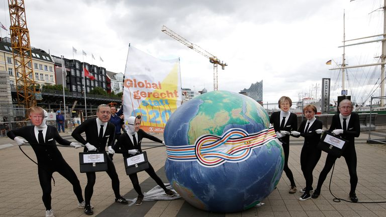 Activists dress as world leaders ahead of the G20 meeting