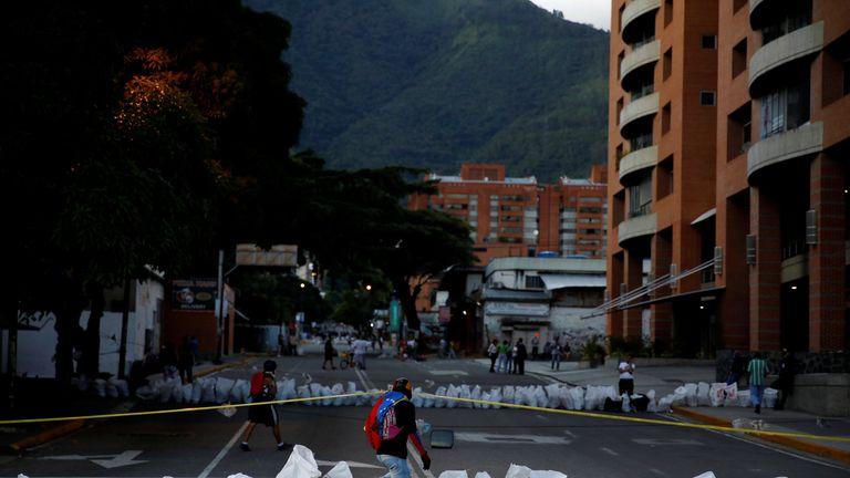 Demonstrators pass through a roadblock