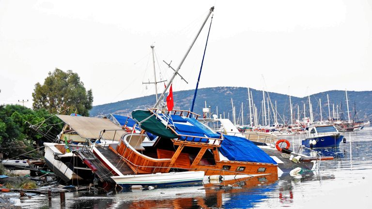 Damaged boats after an earthquake and a tsunami in the resort town of Gumbet in Mugla province, Turkey