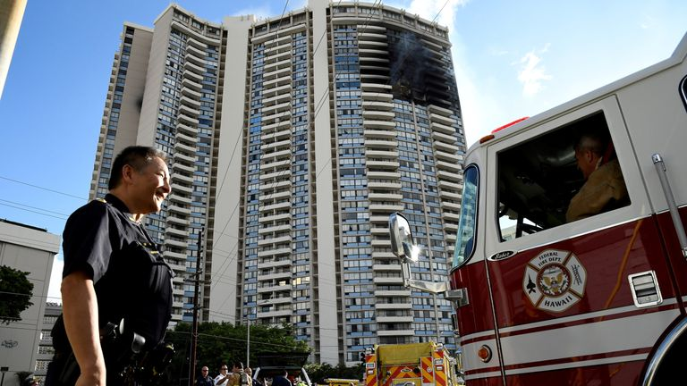 USAA police officer directs a fire truck at the Marco Polo apartment building after a fire broke out in it in Honolulu, Hawaii, July 14, 2017