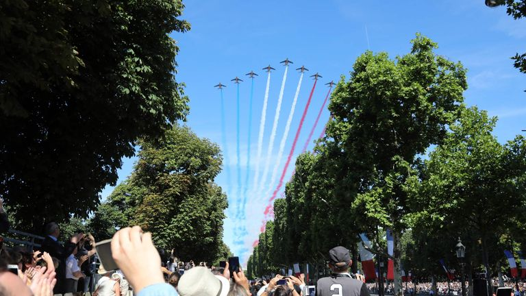 Crowds watch the Bastille Day parade