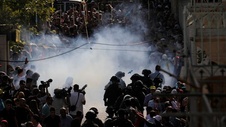 Stun grenades explode at the entrance to the compound known to Muslims as Noble Sanctuary and to Jews as Temple Mount