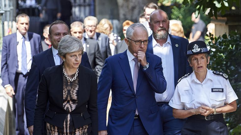 Britain's Prime Minister Theresa May (L), Australian Prime Minister, Malcolm Turnbull (C) and Metropolitan Police Commissioner Cressida Dick (R) arrive to speak to first responders from the emergency services outside Southwark cathedral during a visit to the Borough Market