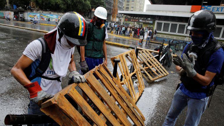 Demonstrators build a barricade