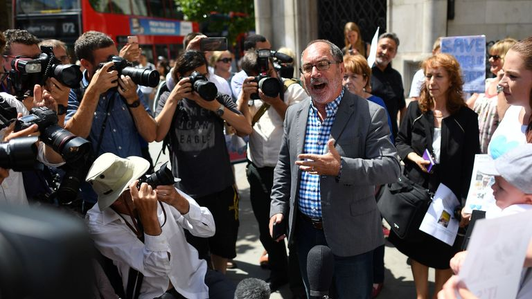 Supporter of Charlie Gard, US Reverand, Patrick Mahoney speaks to members of the media outside the High Court in central London on July 10, 2017
