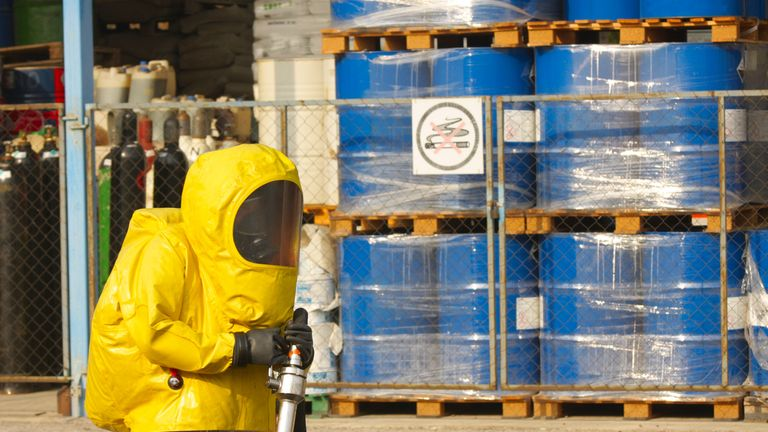 Plant workers collecting hazardous material at a nuclear site