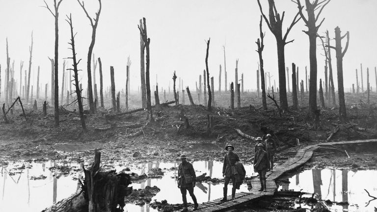 Australian troops walking along duckboards through the remains of Chateau Wood. Pic: Granger/REX/Shutterstock