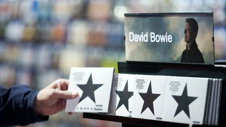 A customer picks up a copy of 'Blackstar' the latest album by British musician David Bowie in a branch of HMV in central London on January 11, 2016. British music legend David Bowie has died at the age of 69 after a secret battle with cancer, drawing an outpouring of tributes for one of the most influential and innovative artists of his time. AFP PHOTO / JUSTIN TALLIS / AFP / JUSTIN TALLIS (Photo credit should read JUSTIN TALLIS/AFP/Getty Images)