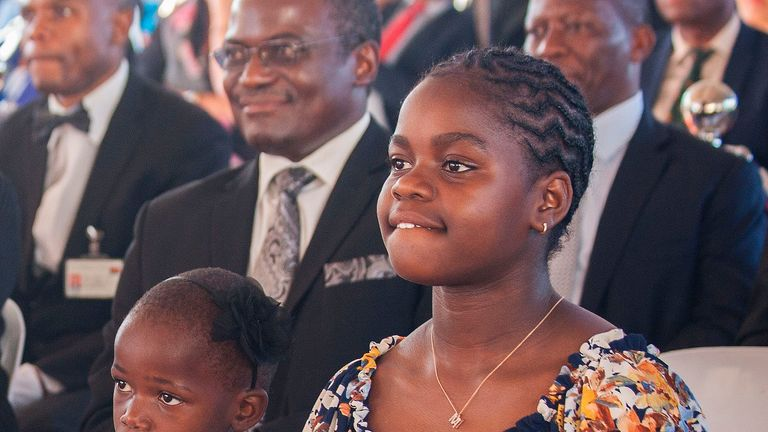 Madonna's adopted Malawian daughter, Mercy James (R), one of her newly adopted children, attend the opening ceremony of the Mercy James Children's Hospital at Queen Elizabeth Central Hospital in Blantyre, Malawi, on July 11, 2017. Madonna on July 11 took her four adopted Malawian children back to their home country for the opening of a paediatric hospital wing that her charity has built. / AFP PHOTO / AMOS GUMULIRA (Photo credit should read AMOS GUMULIRA/AFP/Getty Images)
