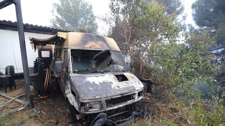 A vehicle damaged in a fire in Carros, southeastern France