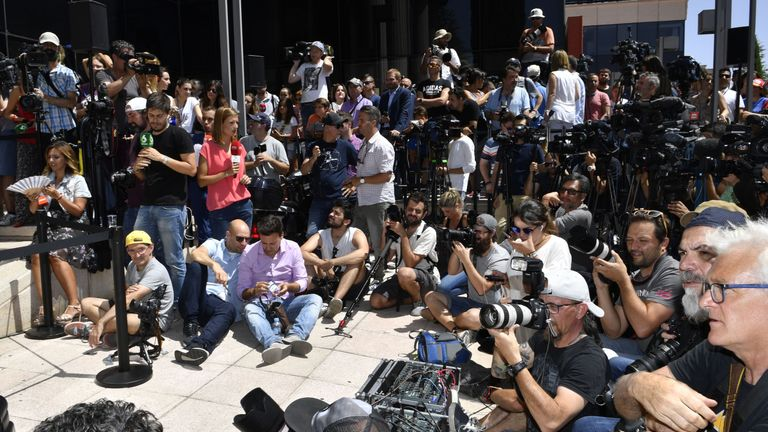 Media wait for Real Madrid's Portuguese forward Cristiano Ronaldo to hold a press point after appearing before a court in Pozuelo de Alarcon, a wealthy suburb of Madrid, on July 31, 2017 to answer on four counts of tax evasion of 14.7 million euro ($16.5m). Procecutors allege Ronaldo took 'advantage of a company structure created in 2010 to hide income generated in Spain from his image rights from tax authorities'. / AFP PHOTO / GERARD JULIEN (Photo credit should read GERARD JULIEN/AFP/Getty Ima
