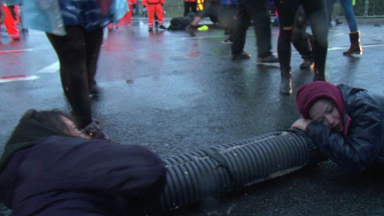 Protesters have resorted to a lock-on tube technique that makes it difficult to move them