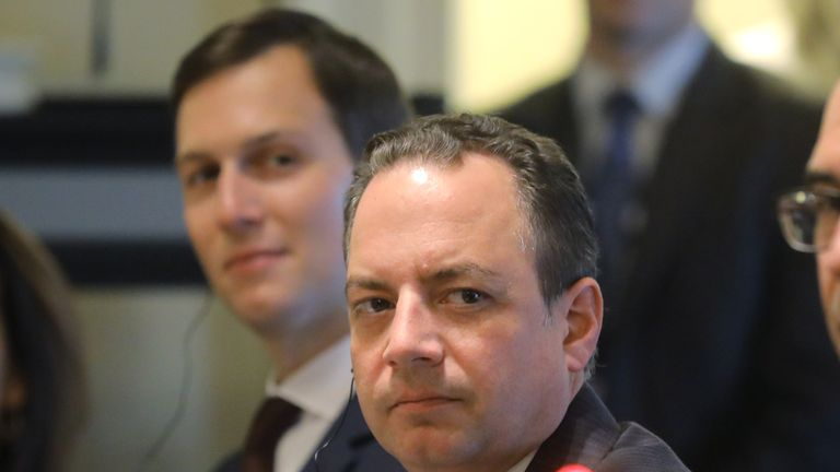Reince Priebus, pictured next to Donald Trump's son-in-law Jared Kushner in June