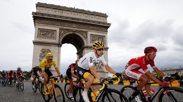 Froome passes the Arc de Triomphe as the 104th Tour de France nears its end