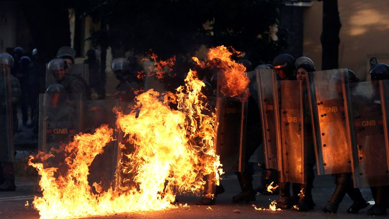 Riot security forces are set on fire