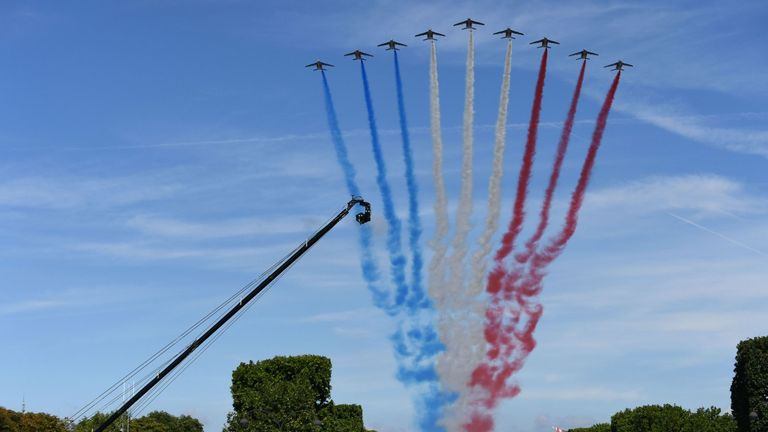 French jets fly down the Champs-Elysees