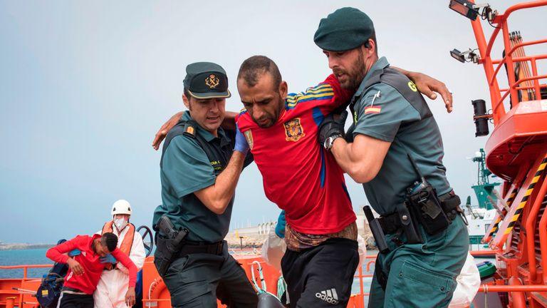 Spanish police rescuing migrants in Gibraltar in June