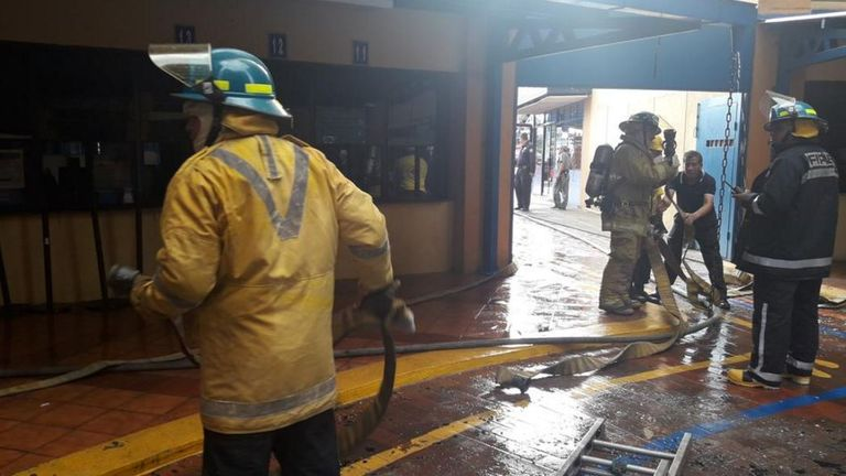 Firefighters inside the Finance Ministry building in El Salvador. Pic: @BomberosES