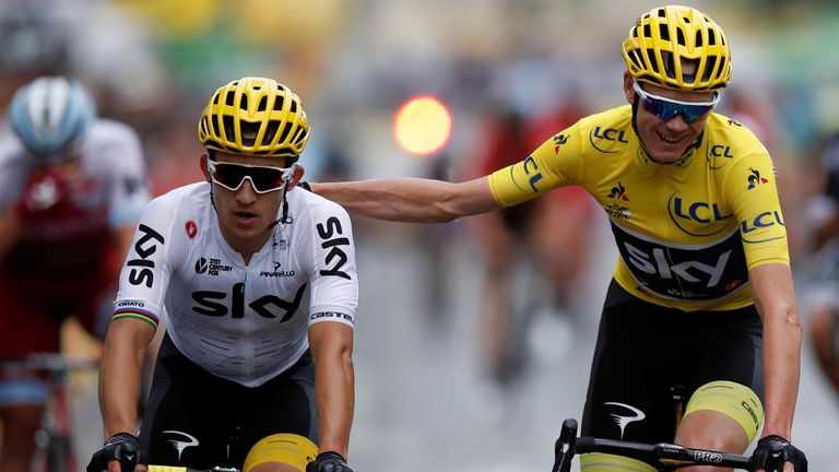 Froome crosses the line with Team Sky's Michal Kwiatkowski
