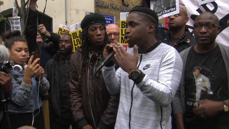 """A speaker at a protest over the death of Rashan Charles says young people increasingly see police as a """"gang""""."""