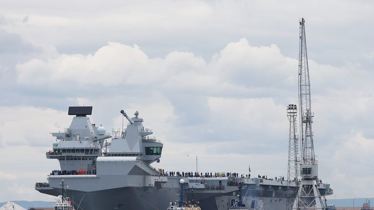 HMS Queen Elizabeth, one of two new aircraft carriers for the Royal Navy, begins to leave the Rosyth dockyard near Edinburgh to begin her sea worthiness trials