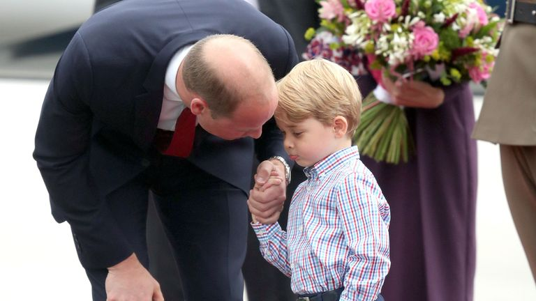 The Duke of Cambridge at Warsaw's Chopin Airport with Prince George
