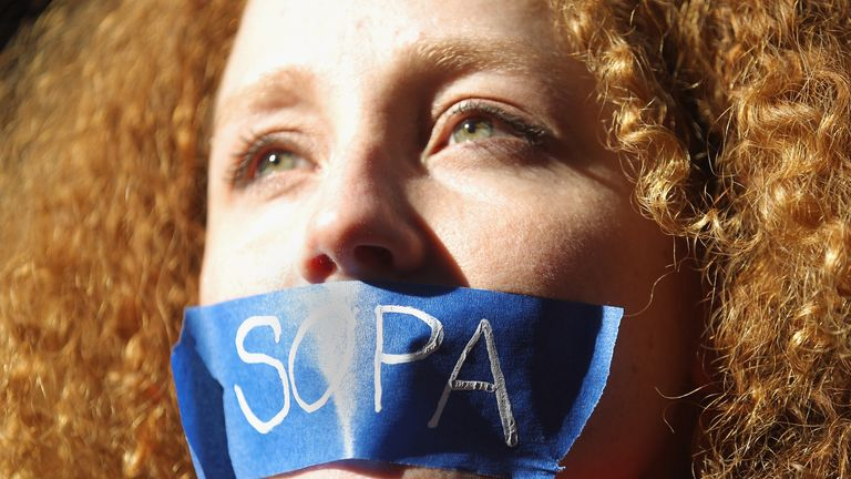 A protester campaigning against SOPA in 2012