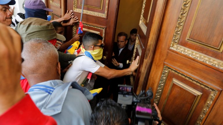 Government supporters try to enter Venezuela's opposition-controlled National Assembly
