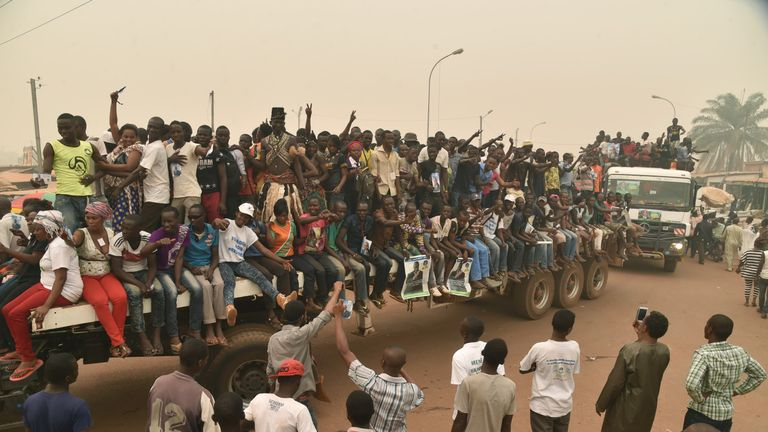 Supporters of a presidential candidate in CAR ride on a flatbed lorry, in an incident unrelated to the crash