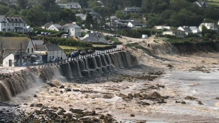 Floodwater pours through the village of Coverack in Cornwall. Pic: Mark Newman