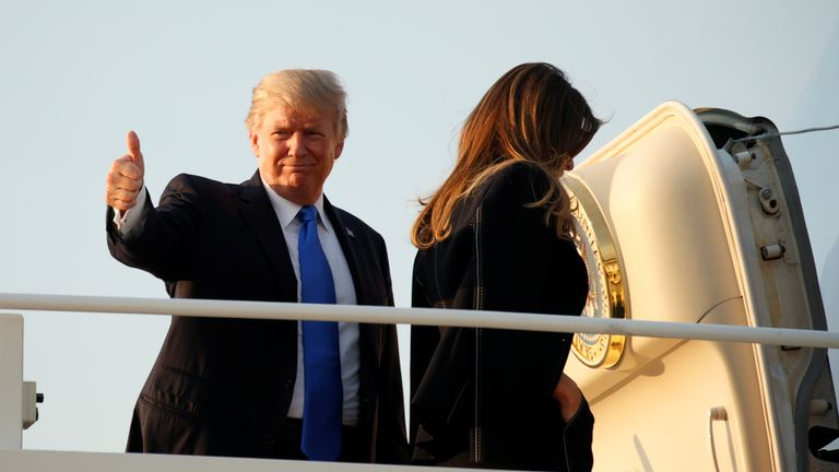 President Trump gave a thumbs up as he departed for Paris with First Lady Melania