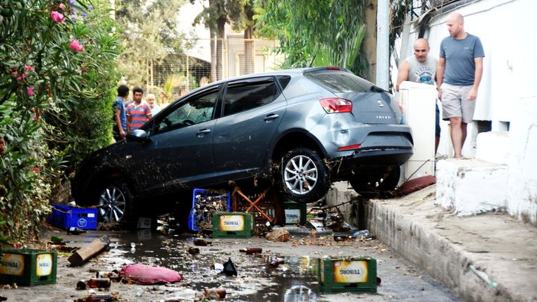 A damaged car after an earthquake and a tsunami in the resort town of Gumbet in Mugla province, Turkey