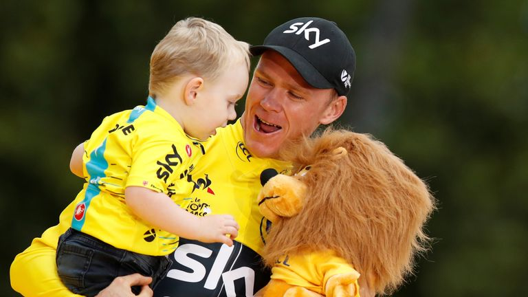 Chris Froome celebrated with his son after winning his fourth Tour de France