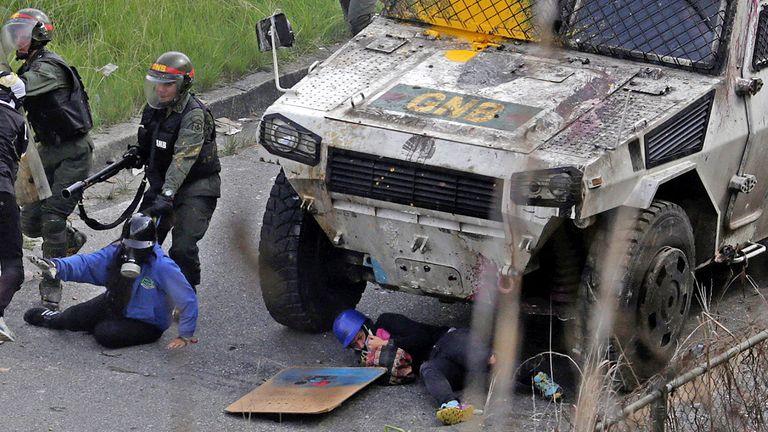 An armoured vehicle hits demonstrators