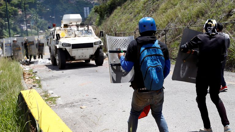 Demonstrators confront security forces during clashes at a rally against Venezuelan President Nicolas Maduro's government in Caracas