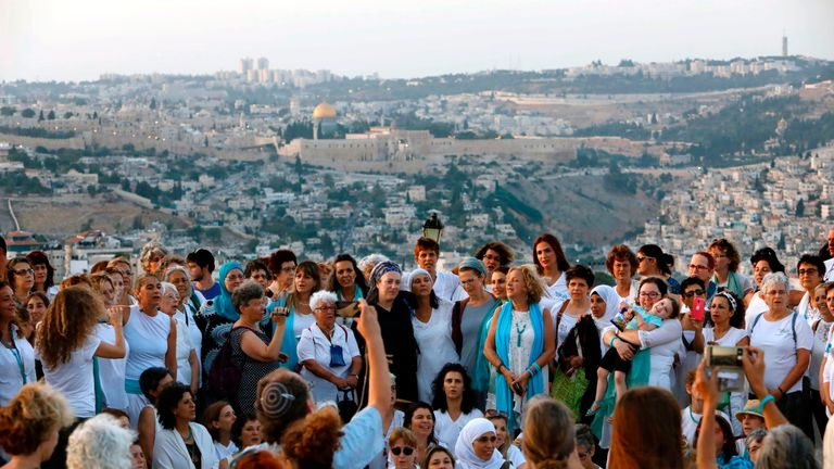 Members of Women Wage Peace gather near the Old City to call for dialogue
