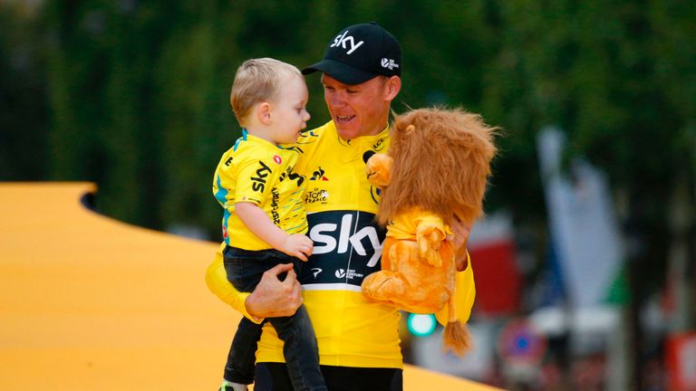 Froome celebrates his win with son Kellan