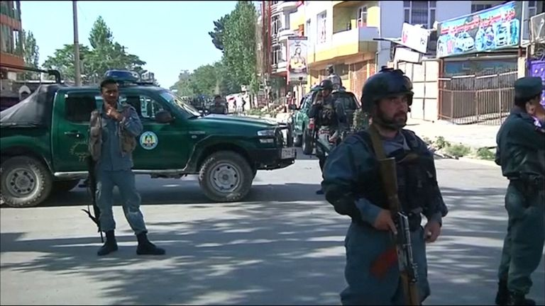 Police at the scene after a bomb in Kabul