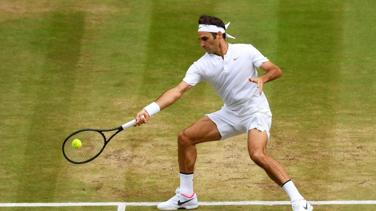 Roger Federer of Switzerland plays a forehand during the Gentlemen's Singles final against  Marin Cilic of Croatia