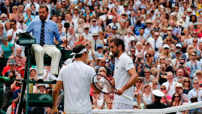 Switzerland's Roger Federer shakes hands with Croatia's Marin Cilic after winning their men's singles final match on the last day of the 2017 Wimbledon