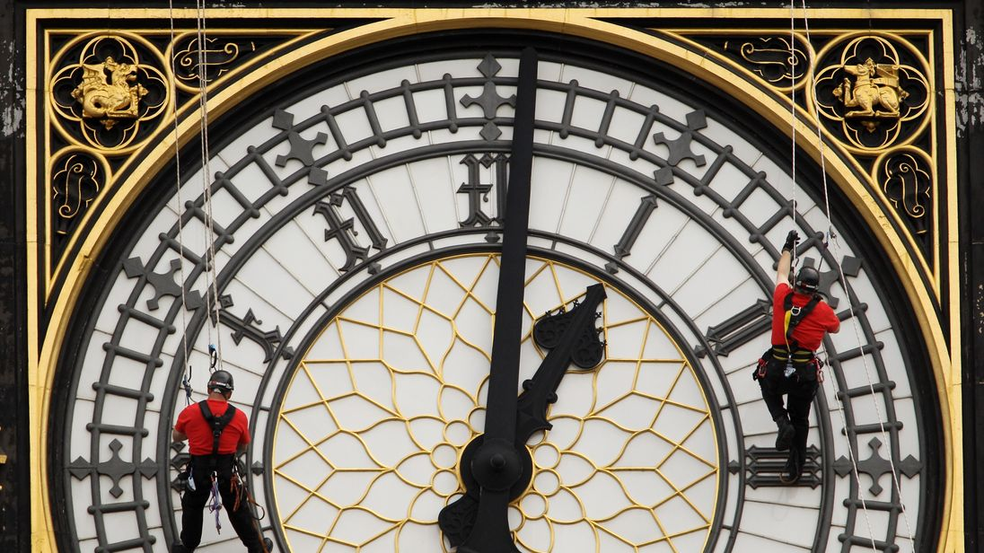 Workers inspecting the clock in 2010