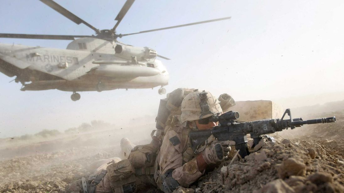 A U.S. Marine from 2nd Marine Expeditionary Brigade, RCT 2nd Battalion 8th Marines Echo Co. during the start of Operation Khanjari on July 2, 2009 in Main Poshteh, Afghanistan