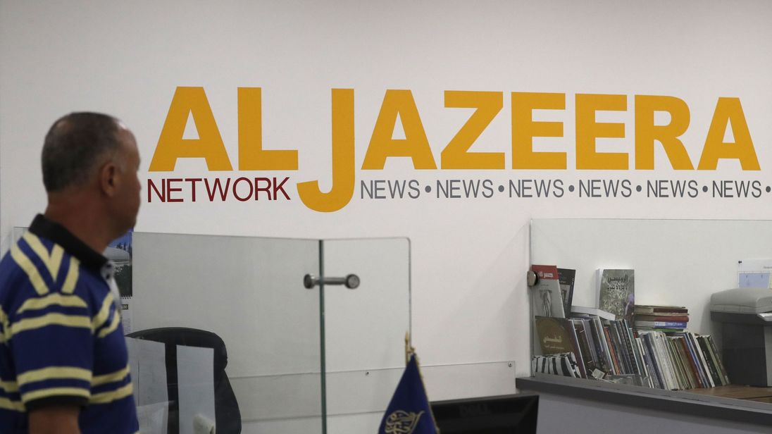 Employees of Qatar based news network and TV channel Al-Jazeera are seen at their Jerusalem office on July 31, 2017, / AFP PHOTO / AHMAD GHARABLI (Photo credit should read AHMAD GHARABLI/AFP/Getty Images)